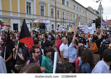 CLUJ - SEPT 1: People join a protest against the Romanian Government that passed a law allowing the gold extraction project at Rosia Montana against the people's will. On Sept 1, 2013 in Cluj, Romania