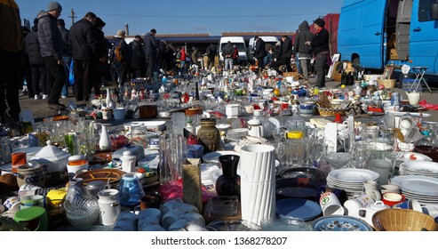 Cluj-Napoca, Cluj / Romania - March 31 2019: The flea market in Cluj-Napoca, also called Oser or Piata de Vechituri. Full of objects on the ground.