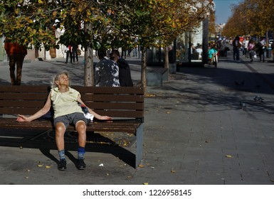 Cluj-Napoca, Cluj / Romania - October 15 2018: Streets of Cluj Napoca, Romania. Here I pictured a homeless man who is resting on a bench in the centre of the city.