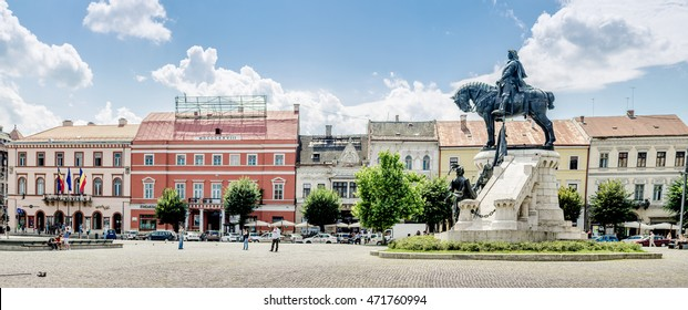 CLUJ-NAPOCA, ROMANIA - 23 JULY 2016: Matei Corvin ( Matthias Corvinus Rex ) statue in the central Unirii Square in Cluj-Napoca in Transylvania region of Romania with beautiful old historic buildings