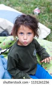CLUJ-NAPOCA, ROMANIA - 28 June 2018: Unidentified people living in the isolated Roma community in Pata Rat, the rubbish dump near Cluj-Napoca, Romania
