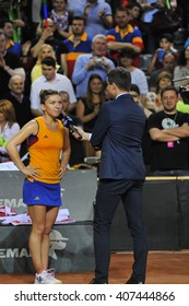 CLUJ-NAPOCA, ROMANIA - APRIL 16, 2016: Romanian tennis player Simona Halep speaks to the audience after her victory in the Tennis Fed Cup play-offs match against Andrea Petkovic from Germany