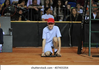CLUJ-NAPOCA, ROMANIA - APRIL 16, 2016:  Ball boy, caddy in action during a Fed Cup tennis match, Romania against Germany