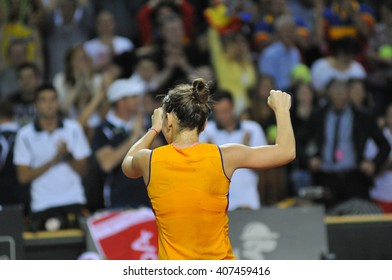 CLUJ-NAPOCA, ROMANIA - APRIL 16, 2016: Romanian tennis player Simona Halep (WTA ranking 6) celebrating her victory against Andrea Petkovic during a Fed Cup match in the World Cup Play-Offs