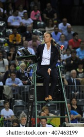 CLUJ-NAPOCA, ROMANIA - APRIL 16, 2016: Chair umpire, tennis referre Eva Asderaki concentrate to game during a Fed Cup tennis match between Romania and Germany