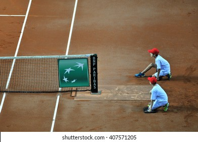 CLUJ-NAPOCA, ROMANIA - APRIL 17, 2016:  Ball boy, caddy in action during a Fed Cup tennis match, Romania against Germany