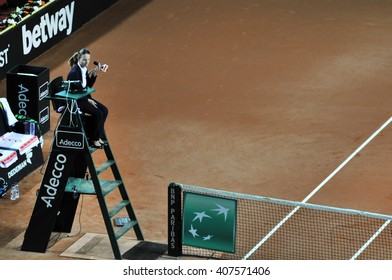 CLUJ-NAPOCA, ROMANIA - APRIL 17, 2016: Chair umpire, tennis referre Eva Asderaki concentrating to game during a Fed Cup tennis match between Romania and Germany