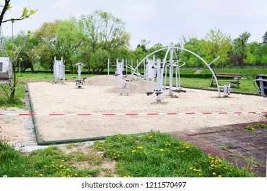 Cluj-Napoca, Romania - April 24, 2018: Flooring upgrade of an outdoor fitness equipment workout sport field. Preparing the sub base for rubber flooring tiles installation inside the rubber border.