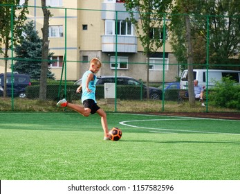 Cluj-Napoca, Romania - August 15, 2018: Young boy kicks the ball to goal on a public football field