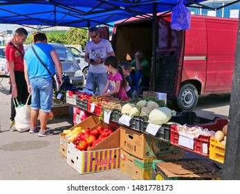 Cluj-Napoca, Romania - August 18, 2019: Farmer family sells their crops at the Sunday market.