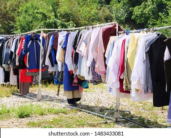 Cluj-Napoca, Romania - August 18, 2019: Secondhand vintage clothes on racks at the flea market.