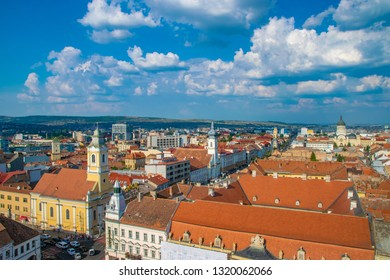 CLUJ-NAPOCA, ROMANIA - August 21, 2018: Cluj-Napoca overview viewed from St. Michael's Church with  Evangelical Church and Unitarian Church in   Cluj-Napoca, Romania