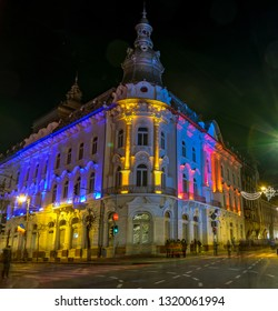 CLUJ-NAPOCA, ROMANIA - December 1, 2018: Beautiful sunset in Cluj-Napoca, Romania: New York or Continental Hotel in Cluj-Napoca, Romania illuminated in the colors of Romanian national flag