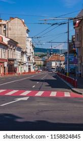CLUJ-NAPOCA, ROMANIA - JULY 29, 2018: empty street scene of Cluj-Napoca in sunny day