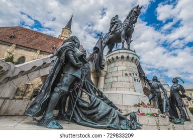 Cluj-Napoca, Romania - July 8, 2016: Matthias Corvinus Monument in front of St. Michael's Church in Cluj-Napoca city in Romania