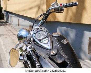 Cluj-Napoca, Romania - June 17, 2019: Kawasaki Vulcan 900 Classic motorbike with tank mounted dashboard, analogue speedometer and warning lights, closeup