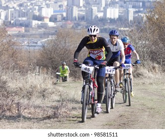 """CLUJ-NAPOCA, ROMANIA - MARCH 24: Unidentified competitor during the Clujul Pedaleaza mountain bike competition, 1st stage """"Napolact"""" on March 24, 2012 in Cluj-Napoca, Romania."""