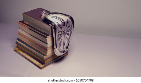 Cluj-Napoca, Romania - Marth 19, 2018: Old books with a melting clock on them.