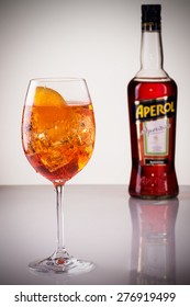 Cluj-Napoca, Romania, May, 11, 2015; Glass of light drink with bottle of Aperol, Aperitivo Poco Alcolico, Liqueur alc. 11%, 1L. Famous Italian aperitif. Produced by DCM S.P.A., Italy