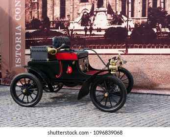 Cluj-Napoca, Romania, May 20, 2018: 1904 Curved Dash Oldsmobile on display. This runabout was the first gasoline-powered, mass-produced automobile with horizontal one cylinder and horsepower 7