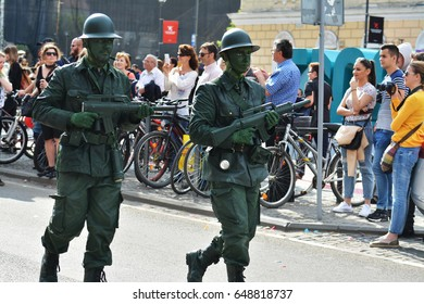 CLUJ-NAPOCA, ROMANIA - MAY 27, 2017: Young men disguised as world war two soldiers hold bayonets in their hands at the opening parade of the Cluj Days festival