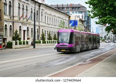 Cluj-Napoca, Romania - May 7, 2017: Purple tram runs on the city street.