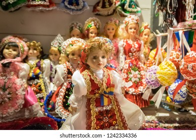 CLUJ-NAPOCA, ROMANIA - NOVEMBER 23, 2018: Traditional dolls at the Christmas market in the Unirii Square, Transylvania, Romania