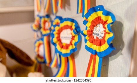 CLUJ-NAPOCA, ROMANIA - NOVEMBER 23, 2018: Romanian flag colors in form of a badge at the Christmas market in the Unirii Square, Transylvania, Romania