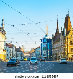 CLUJ-NAPOCA, ROMANIA - OCTOBER 16, 2016: Traffic on a road in the city center of Cluj-Napoca. Cluj-Napoca is the fourth most populous city in Romania
