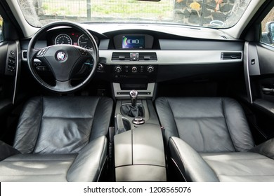 Cluj-Napoca, Romania -Octomber 19, 2018 : inside view through open door inside luxurious iconic isolated BMW series 5, e60 model, year 2007. Leather interior, navigation with big display, clean