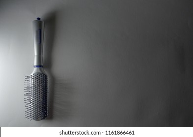 Cluj-Napoca, Romania - Wednesday, August 22, 2018 Hairbrush Top View With Shadow