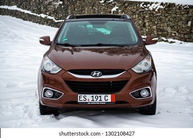 Cluj-Napoca, Romania-January 26, 2019 : Hyundai Tucson - IX 35 4wd, SUV 4x4, all terrain car. Isolated car in a big parking lot full. Snow all around, good contrast. Testing 4wd traction system