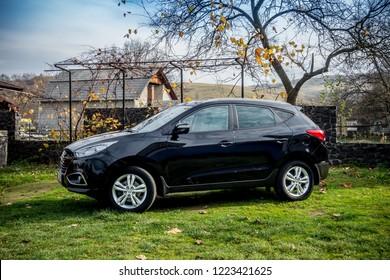 Cluj-Napoca, Romania-November 02, 2018 : Hyundai Tucson - IX 35 4wd, SUV 4x4, all terrain car. Alloy wheels, panoramic sunroof. Reverse camera, automatic gear, parking sensors - isolated in sunny day