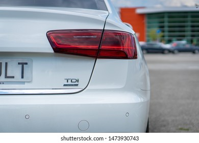 Cluj-Napoca/Cluj/Romania-08.05.2019-Close up photo with the rear bumper, parking sensors, chrome elements and the LED stop of an Audi A6, manufactured in 2016.