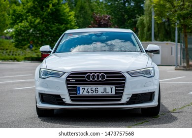 Cluj-Napoca/Cluj/Romania-08.05.2019-Front picture with the boot of a luxury Audi A6 from 2016,chrome grille,LED headlights,pearl white color,Sline inscription,blue tinted windshield,parking sensors
