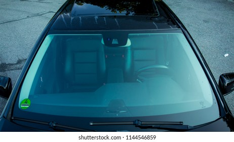 Cluj-Napoca,Romania-July 27,2018:Automotive sunroof with wind deflector and tinted windows close-up. Glazed black hatch,sliding 2012 facelift Mercedes Benz E250 pavilion model,aerial view,outside car