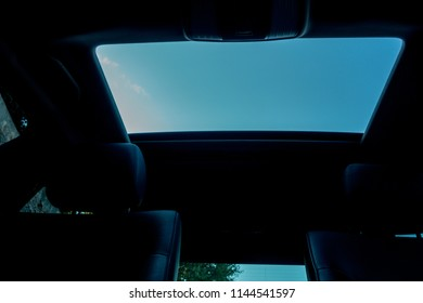 Cluj-Napoca,Romania-July 27,2018:Dark car interior - steering wheel, shift lever and dashboard. Car modern facelift Mercedes E250 model inside view. Front view. Panoramic sunroof close up,