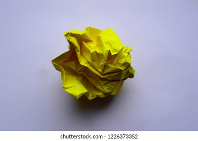 A clump of crumpled yellow paper