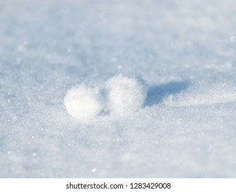 clumps of snow on snowflakes