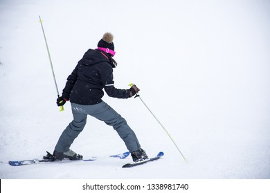 Clumsy amateur skier from back