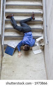 Clumsy business man falling down stairs.