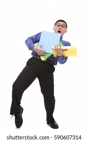 Clumsy businessman carrying folders