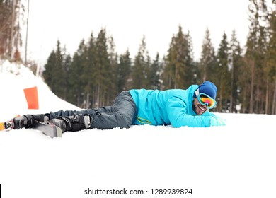 Clumsy skier on slope at resort. Winter vacation