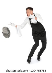 Clumsy waiter dropping empty tray on white background
