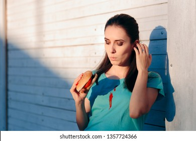 Clumsy Woman Staining Her Shirt with Ketchup Sauce. Lady ruining her t-shirt with tomato sauce eating burger