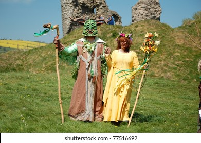 CLUN, UK May 2: The Green Man and May Queen in Clun, Shropshire, UK May 2, 2011.  The Festival takes place on the May Day Bank Holiday and is a traditional springtime festival celebrated annually.