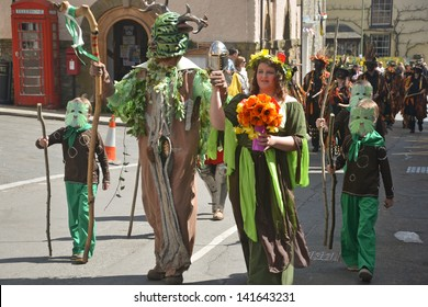 CLUN, UK MAY 6: The Green Man and May Queen in May Day Procession in Clun, Shropshire, May 6 2013. The Green Man Festival is an annual May Day Bank Holiday Celebration.