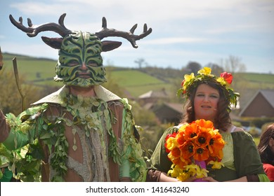 CLUN, UK MAY 6: The Green Man and May Queen in Clun, Shropshire, May 6 2013. The Green Man Festival is an annual traditional May Day Bank Holiday Celebration.