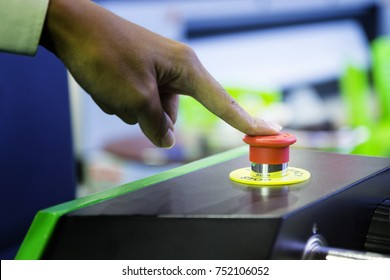 Cluse up emergency stop button push by finger for stopping machine