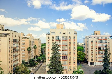 The cluster of 8 floors of 50 years old apartment buildings under the beautiful sky in Anielewicz Street. The picture is taken in summer morning in Ness Ziona, Israel